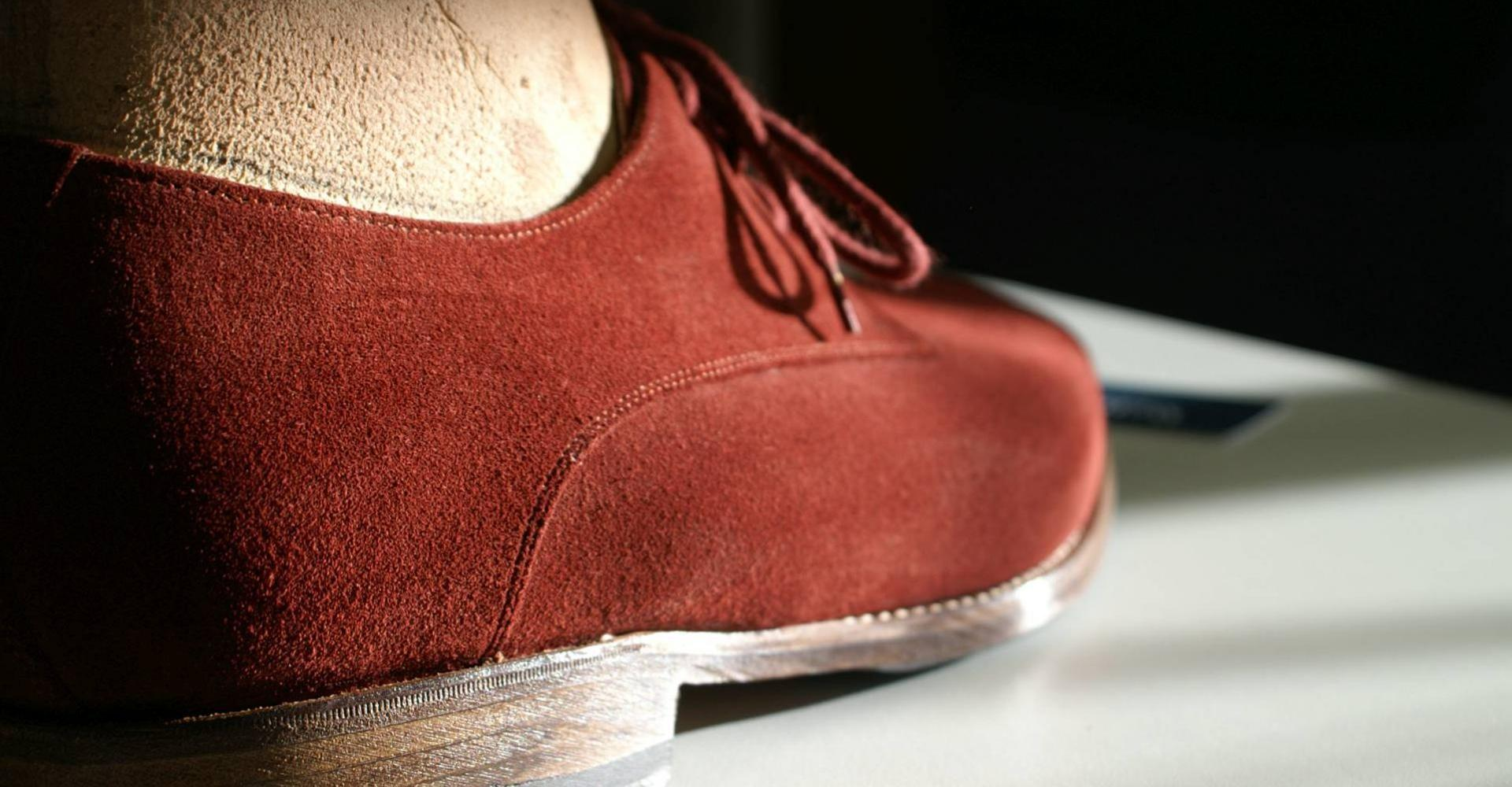 Handmade orthopaedic shoe in red
